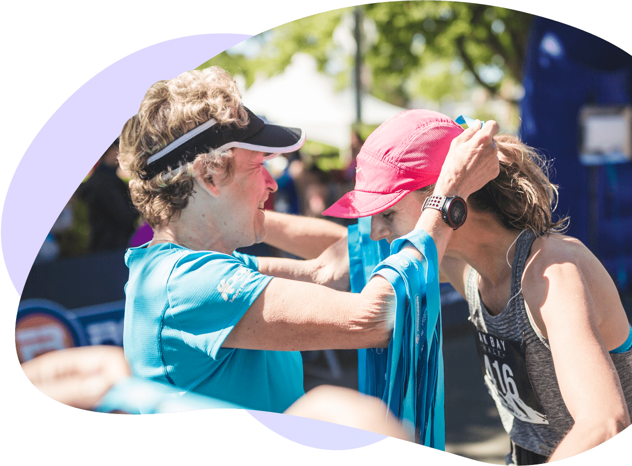 Event organizer putting a medal on a participant